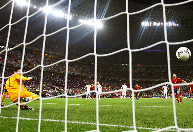 Xabi Alonso scored two goals in his 100th international appearance Saturday, leading Spain to spot in the European Championship semifinals.  Alonso first scored with a thumping downward header in the 19th minute and then converted a penalty in injury time.  The win was Spain's first over France in a competitive match in seven attempts. Spain will next face Portugal on Wednesday in Donetsk as it bids to win a third straight major title.