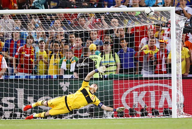 It was an ugly, physical effort from two typically refined sides, but Spain advanced to their third consecutive major tournament final with a 0-0 (4-2) victory in penalty kicks over Portugal -- a shootout that shockingly did not feature Cristiano Ronaldo. In a game that featured 52 fouls and nine yellow cards, Spain's performance was lackluster until extra time while Portugal's approach was tough and defensive all game. Both teams missed their opening penalty kicks, but Cesc Fabregas would clinch the game in the same fashion he clinched the Spain's 2008 quarterfinal against Italy. Ronaldo was due to shoot fifth, but he was never allowed to stare down his club teammate, Spanish goalie Iker Casillas, after national teammate Bruno Alves's shot rung off the crossbar.