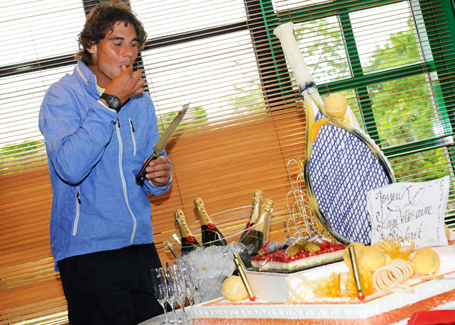 Nadal turned 26 on the middle Sunday, and celebrated on Monday with some cake and a 6-2, 6-0, 6-0 rout of Juan Monaco. Feliz cumpleaños, Rafa.