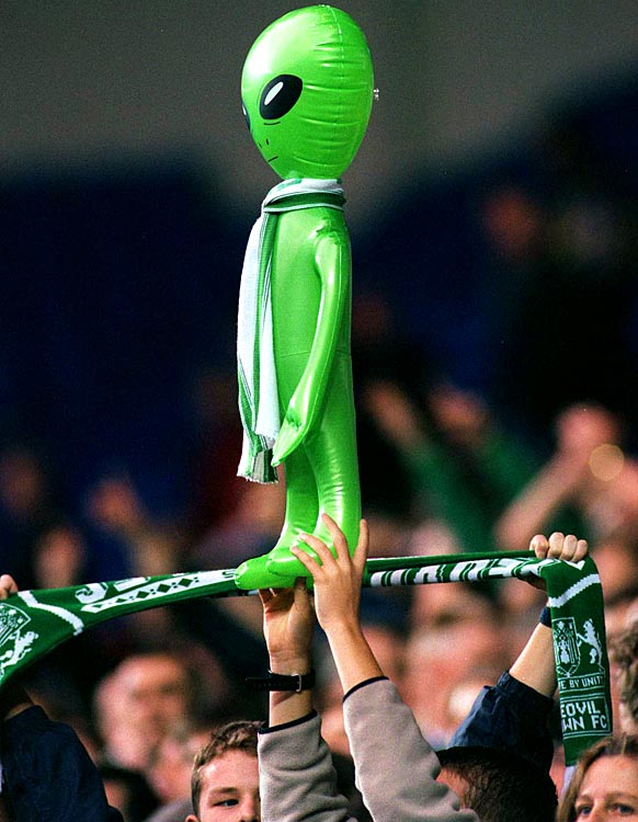 An alien is held amongst the Yeovil fans during the FA Cup First Round between Reading and Yeovil at Madejski Stadium in Reading, England on Oct. 30, 1999.