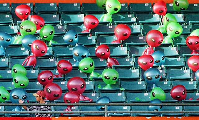 "Aliens occupy the stands during ""Turn Ahead the Clock Night"" before a Brewers-Marlins game on July 23, 1999 at Pro Player Stadium in Miami."