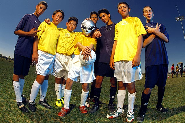 A youth soccer team poses during the UFO Cup Youth Soccer tournament in Roswell, NM on June 21, 2003.