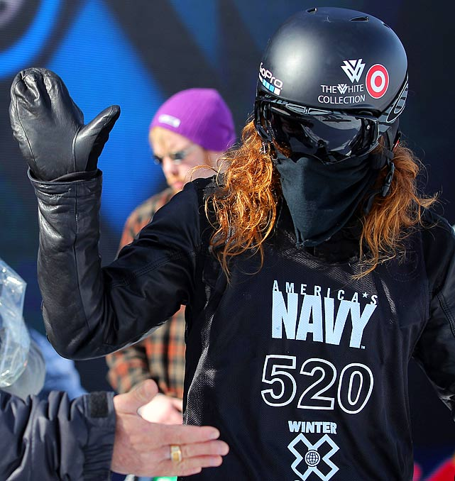 Shaun White looks to give a high five during practice for the men's snowboard superpipe elimination during Winter X Games 2012 at Buttermilk Mountain on Jan. 29, 2012 in Aspen, Colorado.