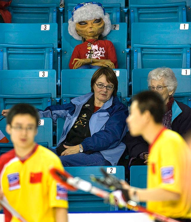 An extraterrestrial doll sits in the stands unnoticed during the World Men's Curling Championships on April 8, 2009 in Moncton, Canada.