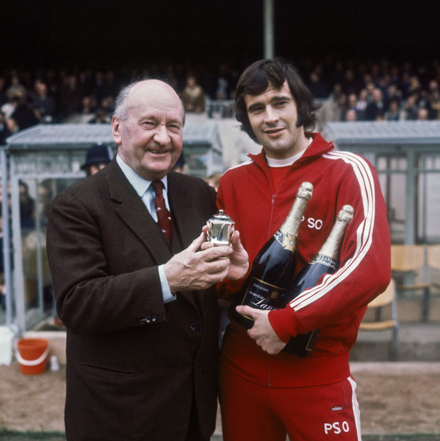 Storey, pictured here with Arsenal club chairman Denis Hill-Wood in 1971, was fined and given a deferred jail sentence in 1979 for running a brothel in East London. In separate incidents, he later served time for funding a counterfeit gold coin operation, smuggling pornographic films and automobile theft.