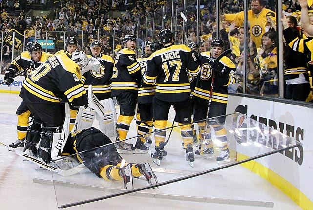Center David Krejci (below left) felt the pane of victory after his team nipped the Washington Capitals 1-0 in Game 1 of their first-round playoff series in Boston.