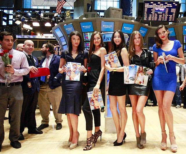 "Crystal Renn, Irina Shayk, Jessica Gomes, Nina Agdal and Michelle Vawer visited the New York Stock Exchange on Valentine's Day to emphasize the fact that America's economy rides on Sports Illustrated 's annual waterwear issue. ""On the morning of its release,"" noted one glassy-eyed fellow on the floor, ""the gears of this great land grind to a halt and start to rust from all the drool."""