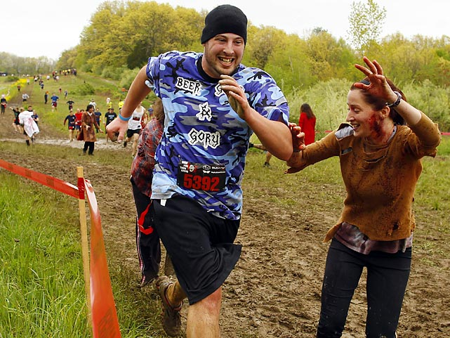 "Call it The Running Dead. In Amesbury, Massachusetts, contestants navigated man-made and natural obstacles while being pursued by zombies that attempted to remove the ""health"" flags from their belts and, we assume, eat them."