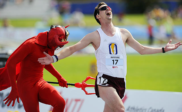 Ol' Beelzy prods David Therrien off the track in the men's 5000m at Donovan Bailey Invitational Track and Field Meet in Edmonton. The runner in last place after each lap is chased by Satan, and if stabbed, is declared out of the race.