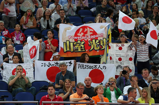 Japanese fans cheer on their team in the Artistic Gymnastics Men's Team final during Day 3 of the Olympics.