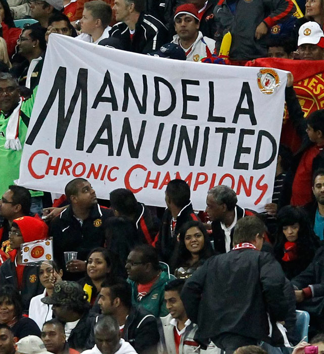 Fans display a banner paying tribute to Nelson Mandela on his 94th birthday during a match between Amazulu and Manchester United in Durban.