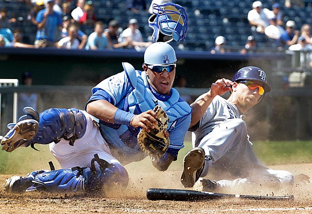 Tampa Bay's Ben Zobrist tries to score from third base during the eighth inning of a June 27 game in Kansas City.  Royals catcher Salvador Perez loses his mask as he tags Zobrist out at home. The Royals won 5-4 to complete a three-game sweep.