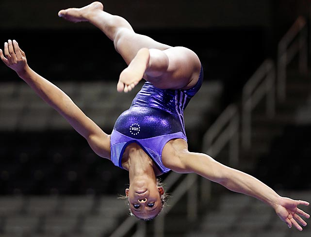 Kennedy Baker goes through her balance beam routine during practice at the U.S Olympic trials.  The 16-year-old finished eighth overall at the trials and failed to the make the team for London.