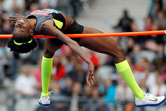 U.S. Olympic high jumper Chaunte Lowe arches over the bar at an IAAF Diamond League meet in Paris.  She defeated Ukrainian Olena Kholosha in the finals by clearing a height of just over 6 feet, 5 1/2 inches.