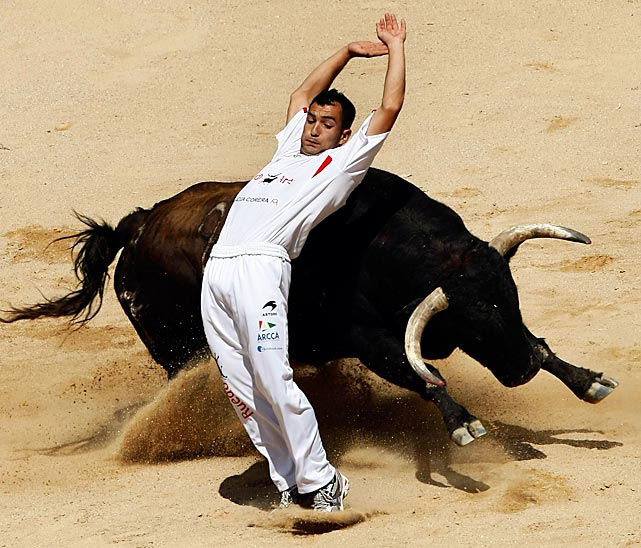 A recortador performs a pass on the third day of the San Fermin festival in Pamplona, Spain, on July 8.