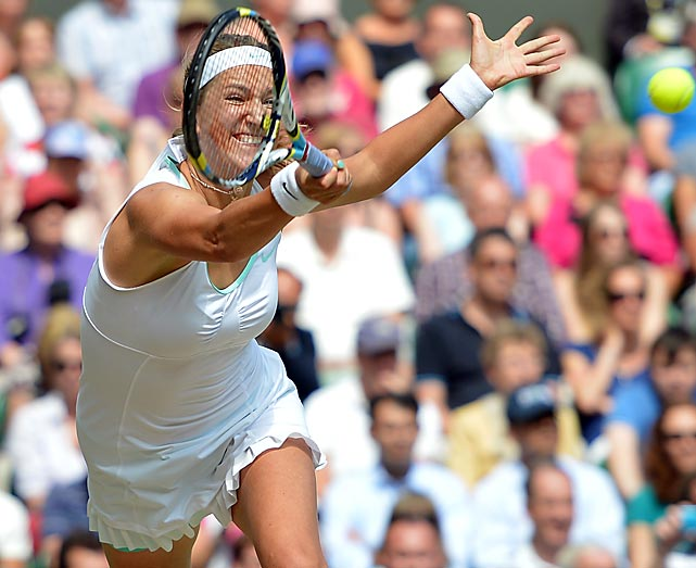 Victoria Azarenka reaches out for a forehand return during her loss to Serena Williams in the Wimbledon semifinals on July 5. Williams served a tournament-record 24 aces in the 6-3, 7-6 (6) victory.