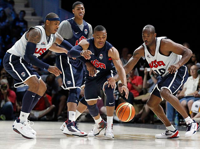 Kobe Bryant (right) and Carmelo Anthony (left) double-team Russell Westbrook during an intra-squad scrimmage on Saturday.  The young Anthony Davis (behind) looks on.