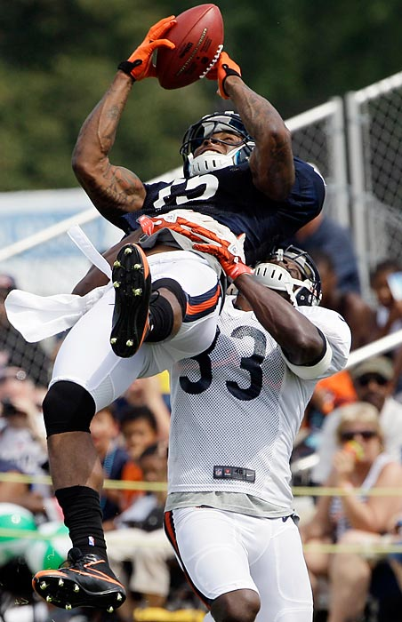 Offseason acquisition Brandon Marshall makes an acrobatic catch over cornerback Charles Tillman at Chicago Bears training camp in Bourbonnais, Ill.