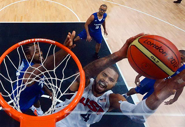 Tyson Chandler goes for a dunk on Sunday against France. Chandler had eight points in 10 minutes, helping Team USA defeat France 98-71.