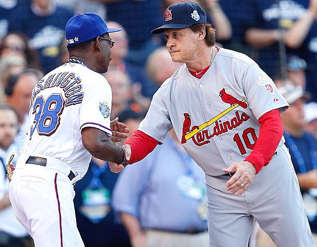 American League manager Ron Washington (left) greeted National League manager Tony La Russa before the game. La Russa, who managed the Cardinals to a World Series title in 2011, retired after the season.