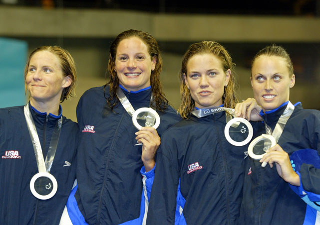 The women's 4x100m relay team (from left) Jenny Thompson, Lindsay Benko, Natalie Coughlin and Amanda Beard show off their silver after claiming second at the 10th World Swimming Championships in Barcelona.