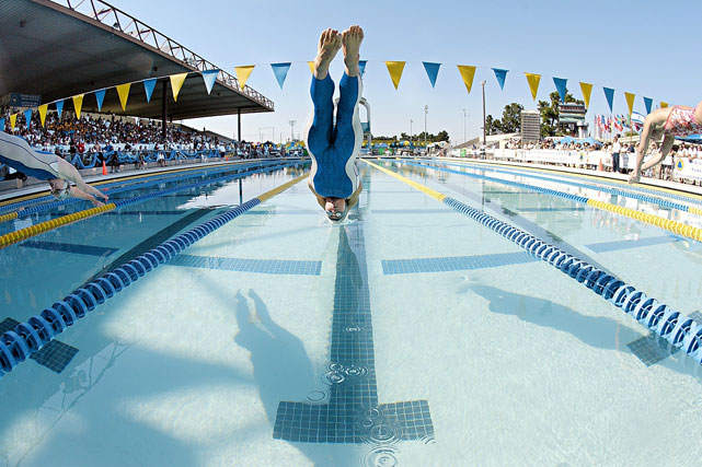 Coughlin dives into action at the start of the 100m freestyle finals during the Santa Clara International Meet in 2006.