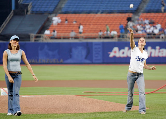Coughlin (left) and teammate Amanda Beard throw the ceremonial pitch at a Dodgers game on Sept. 15, 2004.