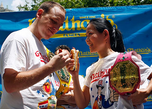 Thomas (seen here with Joey Chestnut at the weigh-in), weighs just 100 pounds, and will headline the Women's Hot Dog-Eating World Championship against 14 female eaters from the U.S. and Canada.