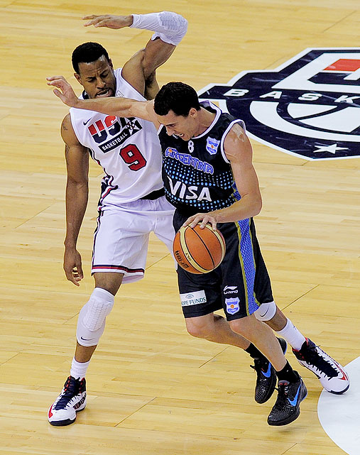 Andre Iguodala (left) saw limited minutes for Team USA, but made the most of his time on the court, hounding Argentina on defense from one baseline to the other.
