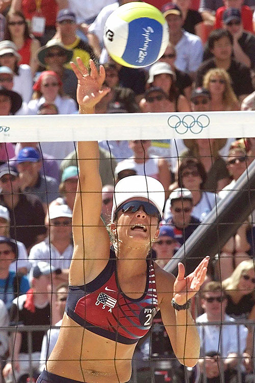 May (now May-Treanor) partnered not with Kerri Walsh, but with Holly McPeak at the 2000 Olympics. They were favored to win gold but lost in the quarterfinals to a Brazilian pair. May-Treanor and Walsh are going for a third straight beach volleyball gold in London, but the favorites are from Brazil.