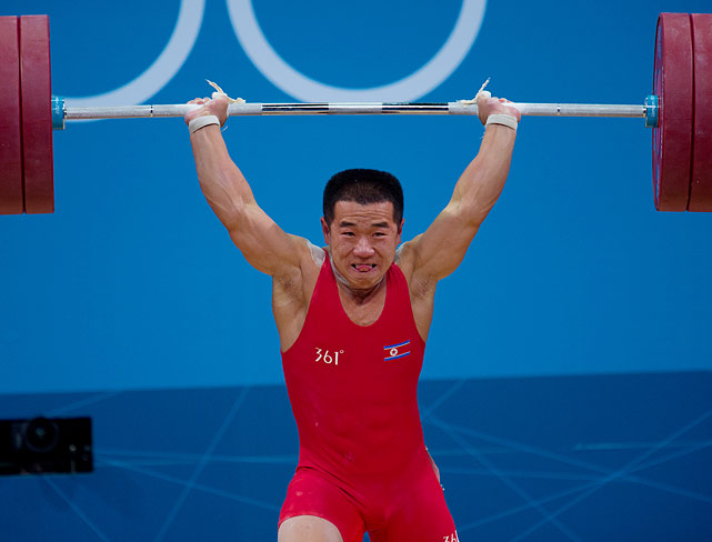 Yun Chol Om of Korea celebrates breaking the Olympic record in the 56kg group.
