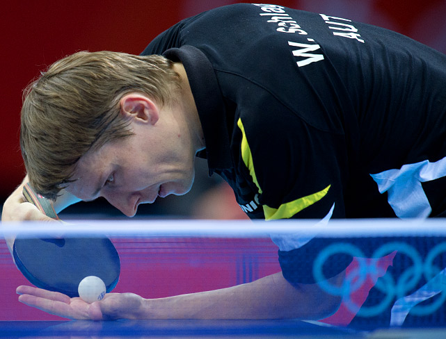 Werner Schlager of Austria serves during the table tennis competition.