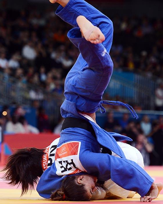 Japan's Kaori Matsumoto (white) duels with Azerbaijan's Kifayat Gasimova (blue) in a women's 57kg judo match.