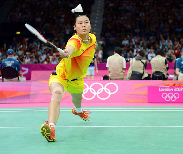 Pui Yin Yip of China battles against Ji Hyun Sung of Korea in the Women's Singles Badminton competition.