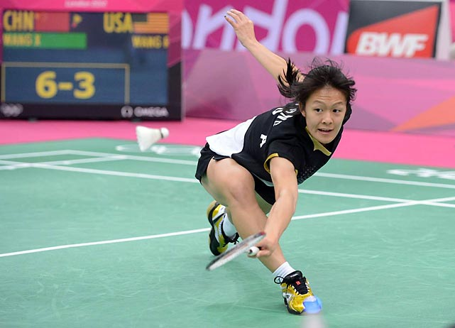 Rena Wang of the U.S. found herself a little overextended in her group play match against China's Wang Xin, the no. 2 seed in women's badminton, losing 2-0.