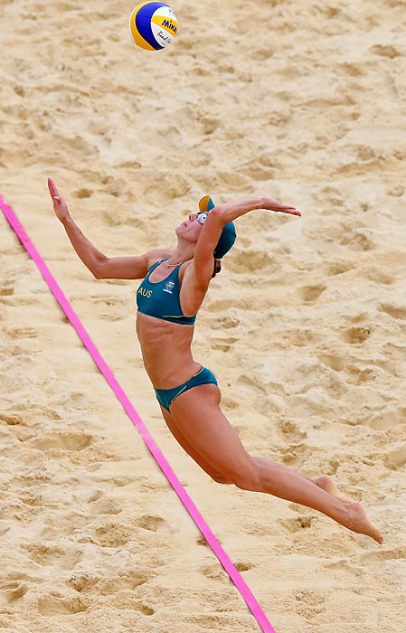 Louise Bawden of Australia returns the ball to the Netherlands during a preliminary match on Day 4 of the London Olympics.