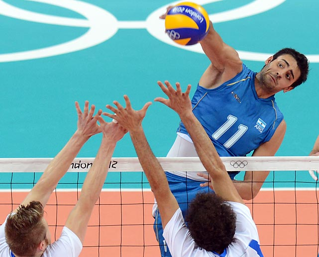 Sebastian Sole of Argentina spikes during a match against Italy, ending in Argentina's 3-1 loss to Italy.