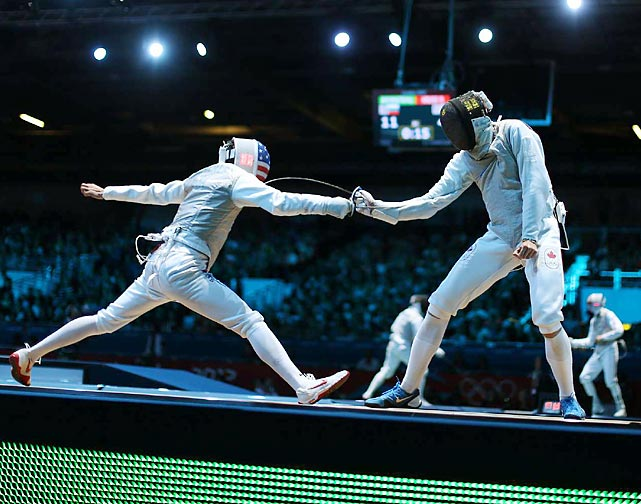 American fencer Alexander Massialas lunges at his opponent, Etienne Lalonde Turbide of Canada, during Round 32 of the Individual Foil.