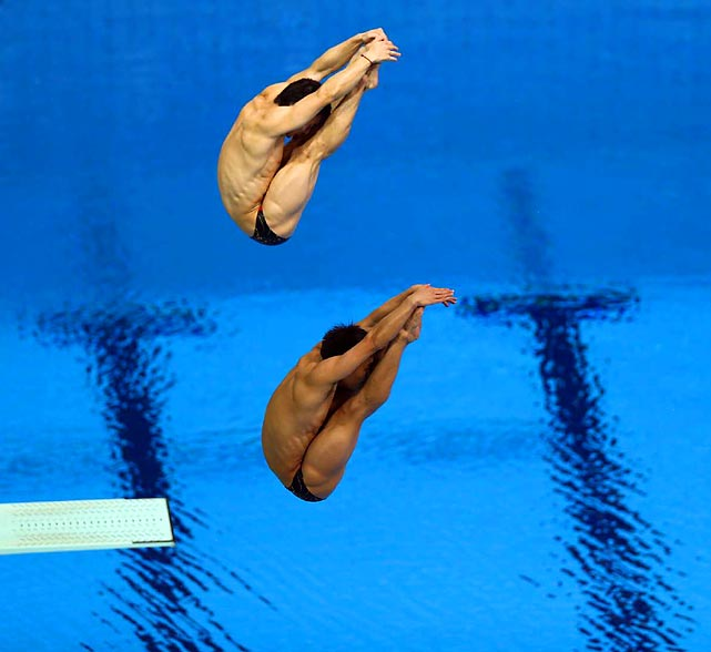 Qin Kai (top) and Luo Yutong made a point of getting their act together to win the men's sychronized three-meter diving title, giving China its third gold in as many diving finals at London. The U.S. pair of Kristian Ipsen and Troy Dumais took the bronze.