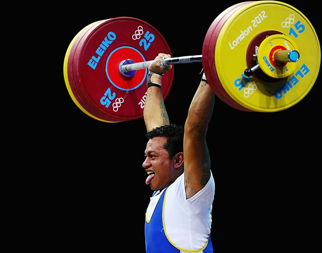 Toafitu Perive of Samoa fights to lift his weight during the men's 77kg final.