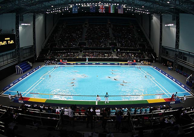Located close to the Aquatics Centre within one of the most compact areas of Olympic Park in the southeast corner near the Olympic Stadium, the temporary Water Polo Arena has just enough room for 5,000 seats around the competition pool and a second warm-up pool. Ancillary operations for the arena will actually take place at the Aquatics Centre.