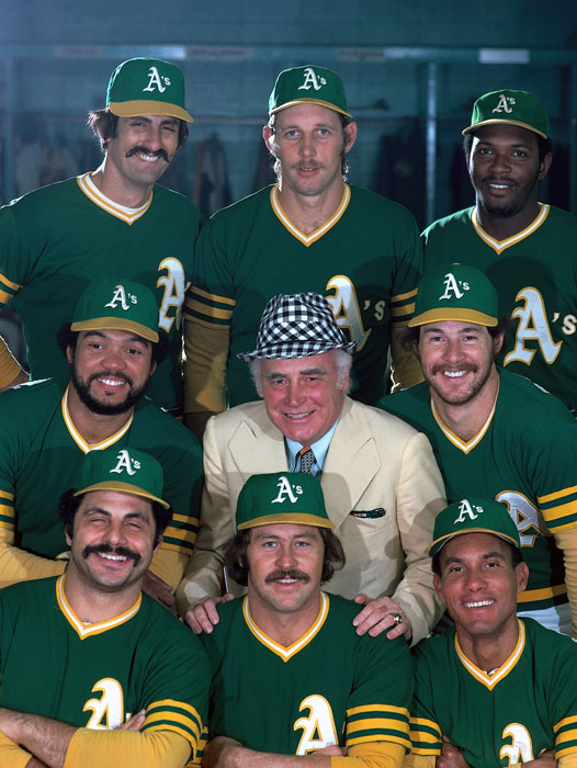 Jackson (middle left) poses with Oakland Athletics teammates and owner Charlie Finley in 1974. Although Jackson left the Athletics in 1975, he returned in 1987 for one last season before he retired.