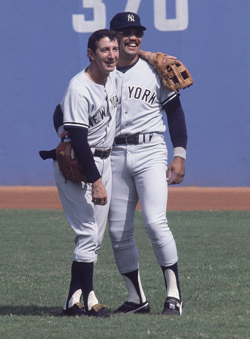 Yankees Manager Billy Martin stands with Reggie Jackson in the field before Game 5 of the 1977 World Series against the Los Angeles Dodgers. After the Yankees won in six games, Jackson was named the MVP for the second time in his career.