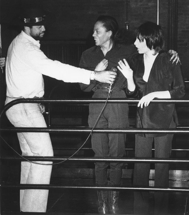 Jackson hands a microphone to legends Diana Ross and Liza Minelli while visiting New York's Studio 54 in Feb. 1980.