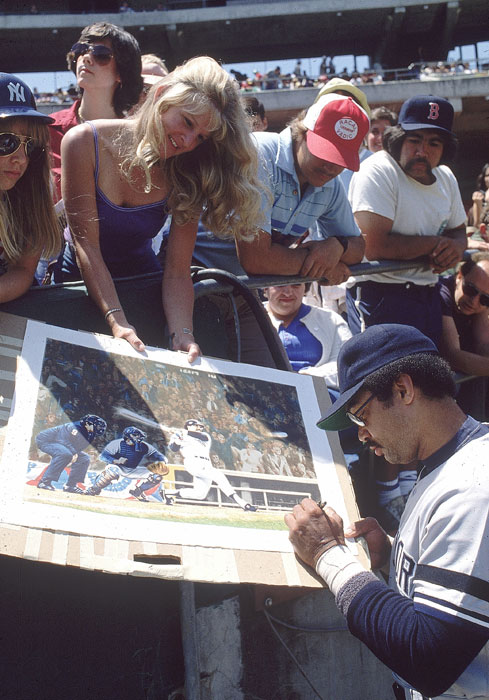 Jackson signs an autograph for a fan before a 1980 game against the Red Sox.