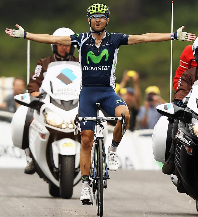 Spain's Alejandro Valverde of Movistar won his third Tour de France stage victory in a breakaway, beating Christopher Froome and Tour leader Bradley Wiggins by 19 seconds.