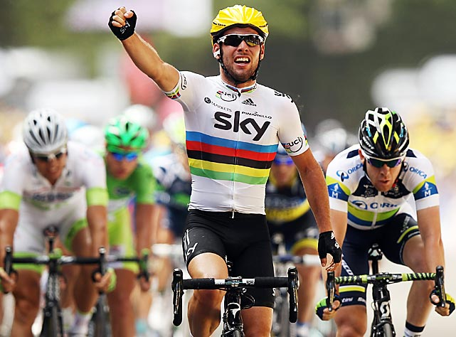 World champion Mark Cavendish of Great Britain celebrates his Stage 2 victory in Tournai, Belgium. This marked Cavendish's 21st stage win in six years, with his perfectly timed sprint helping him edge Andre Greipel.