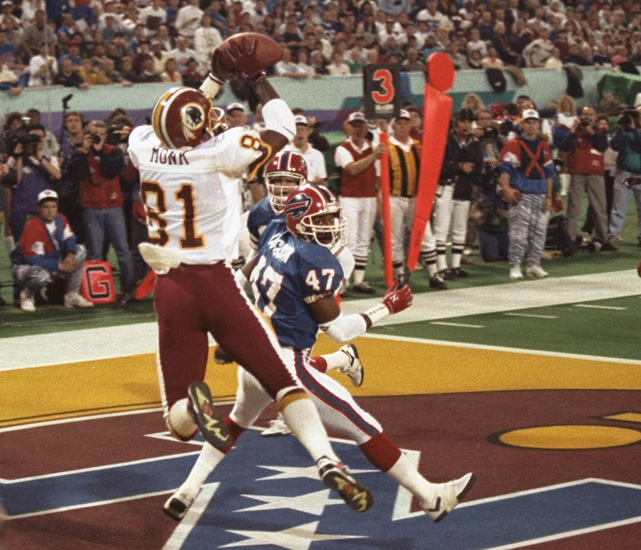 Art Monk (81), leaps in the back of the end zone to make a touchdown catch during Super Bowl XXVI in Indianapolis.  The Redskins defeated the Buffalo Bills 37-24, and Monk had seven catches for 113 yards including this touchdown.
