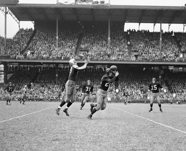 Redskins' halfback Dan Sandifer (right) catches a Boston Yanks pass intended for Bill Chipley (left).  Sandifer took the interception 40 yards for a Redskins touchdown.