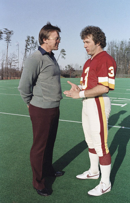 Redskins kicker Mark Moseley converses with head coach Joe Gibbs during a practice on January 3rd.  Moseley was named the MVP of the strike-shortened season of 1982--the only placekicker to ever win the award.